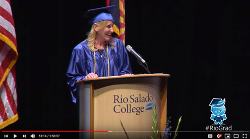 snapshot of Papworth at commencement lectern