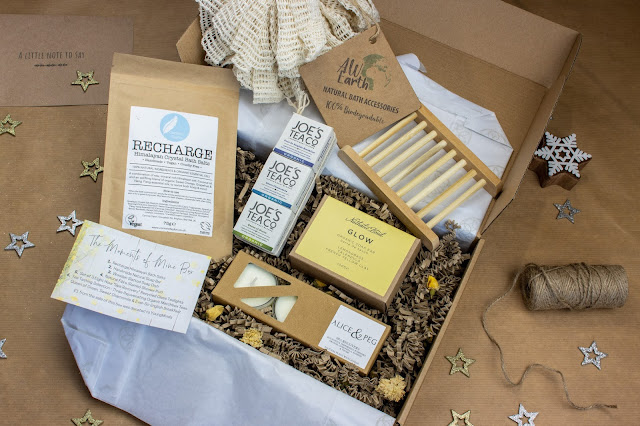 An eco gift set for some quality time with vegan candles, bath salts, tea, soap, shower puff and soap rack.