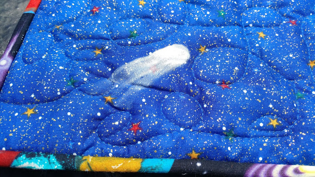 Painted comet on Solar system quilt