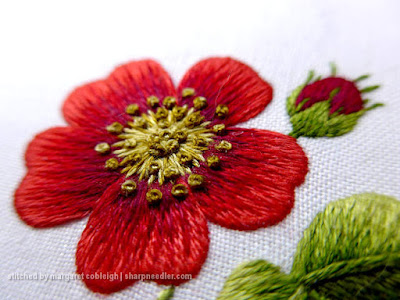 Completed centre of needlepainted rose with French knots.