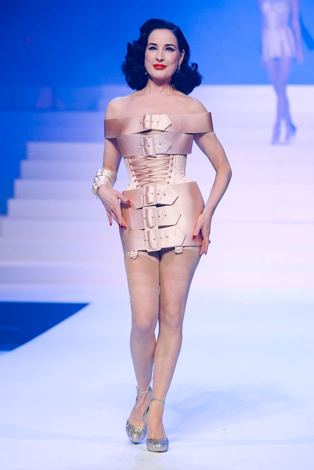 Dita Von Teese, 47, cuts a sultry figure as she walks the runway in minidress made of belts at Paris Fashion Week