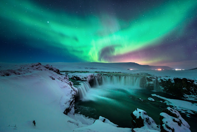 The Northern Lights over Godafoss Waterfall are the perfect romantic evening