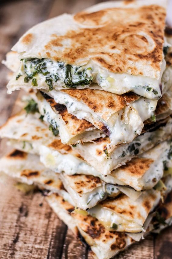 Spinach & Artichoke Quesadillas - Full of baby spinach, artichoke, and CHEESE! Ooey, gooey and majorly delicious!