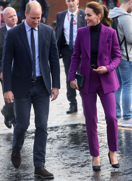 Kate Middleton wore a purple suit by Emilia Wickstead. Emmy London Josie pumps and Jaeger quilted bag