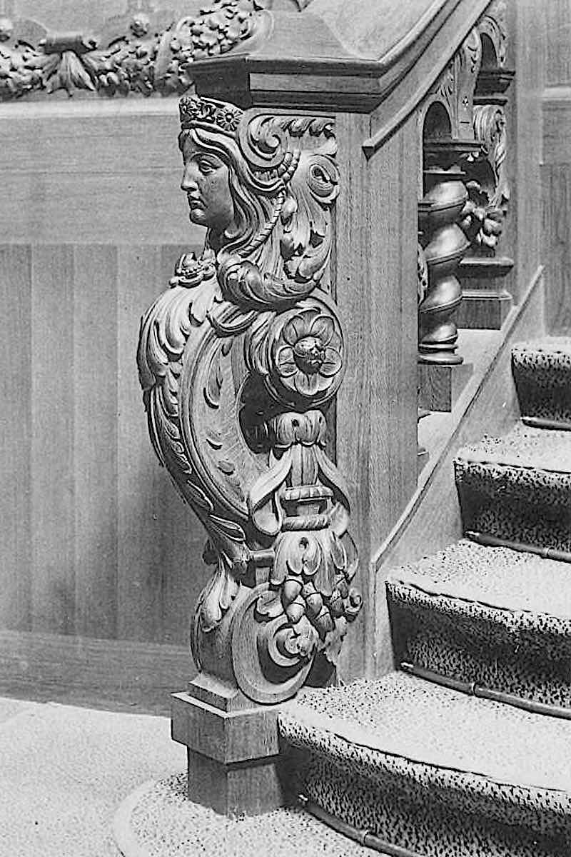 a photograph of an 1897 carved wood stair post