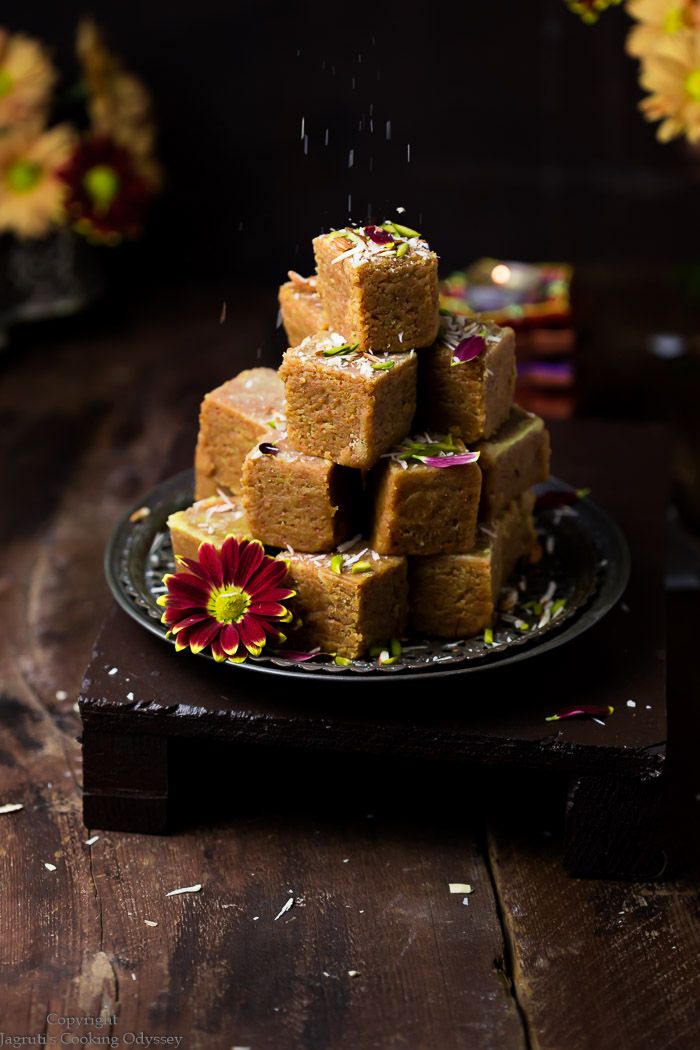 Gujarati style chickpea flour fudge stacked on a plate