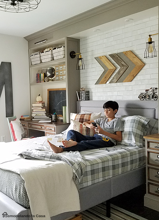 grey and white - neutral room decor in this boy room - Teen boy laying on bed