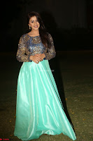 Nikki Galrani in Green Skirt  Top at Marakathamani music launch ~  Exclusive (147).JPG