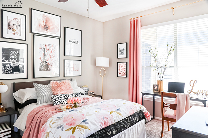 Paris bedroom makeover with gallery wall, gold ornate mirror and lots of pink