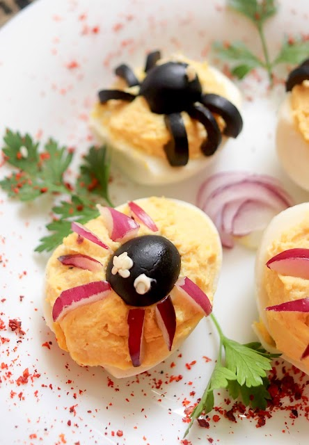 spider deviled egg with onion legs.