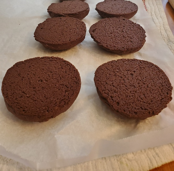 these are baked chocolate half moon cookies cooling