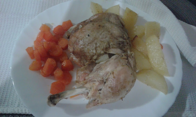 baked chicken with carrots and potatoes in oven