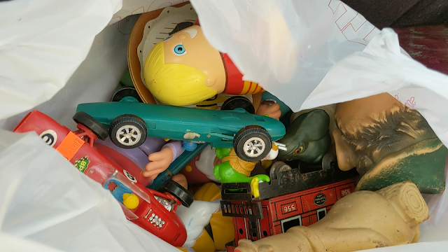 picture of a bag filled with vintage toys