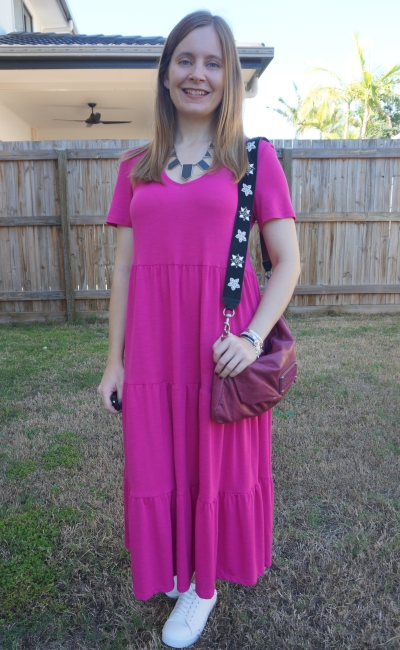 Kmart short sleeve tiered jersey dress in Fuchsia with marc by marc jacobs convertible clutch worn crossbody and sneakers | away from blue