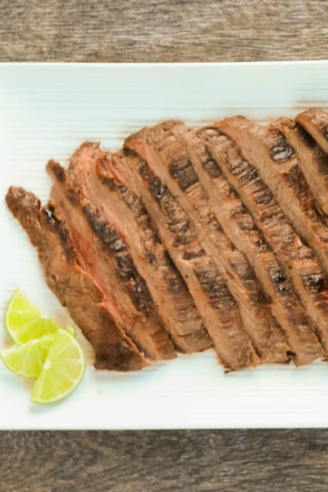 Easy Carne Asada recipe is a delicious marinade recipe for tacos, burritos, salad or just as is. Super tender Carne Asada from Serena Bakes Simply From Scratch.