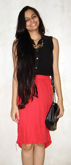 red skirt, dipped hem, black shirt, gold necklace, mumbai fashion blogger