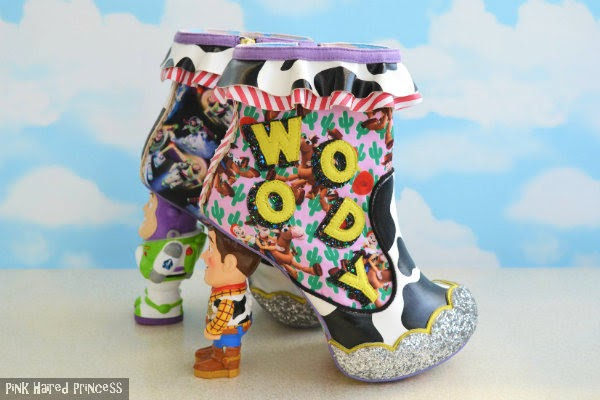 pair of ankle boots with buzz boot in background woody in foreground side view