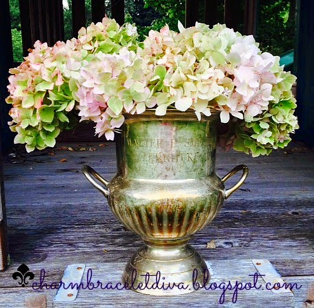 vintage champagne bucket filled with hydrageas