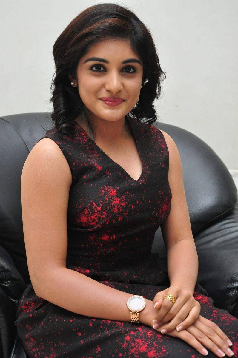 Niveda Thomas Smiling Photos In Red Dress