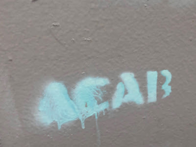 ACAB, smeared paint
