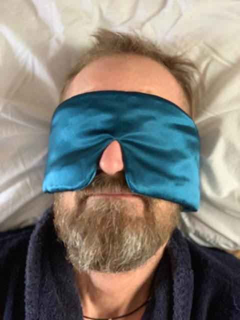 bearded man wearing Sleep Master Deluxe Sleep Mask