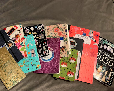 several sizes and types of notebooks