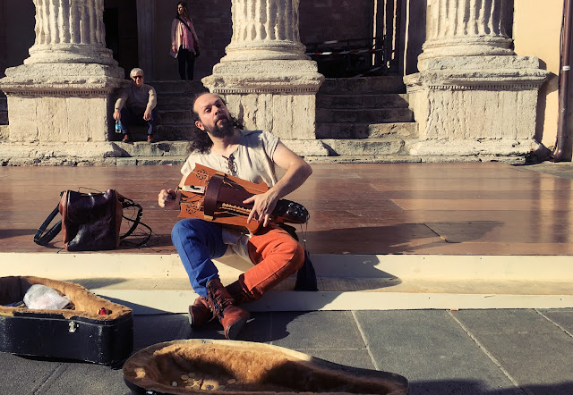 Street musician in Assisi, Italy