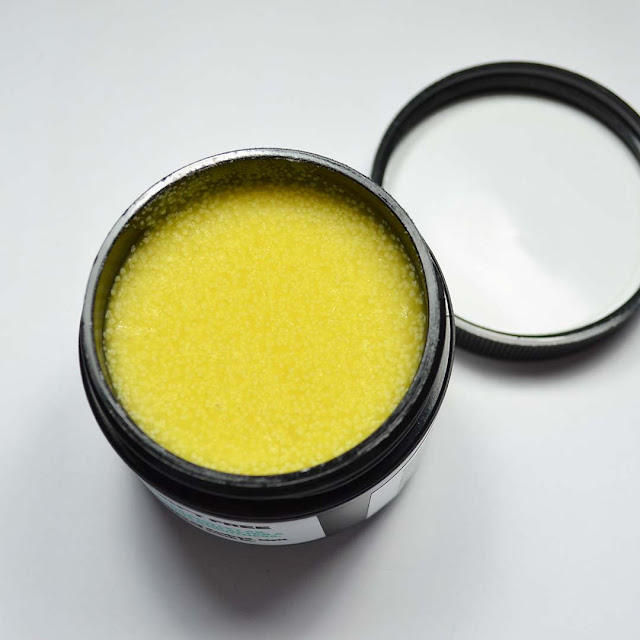 healing balm formula shown in a jar
