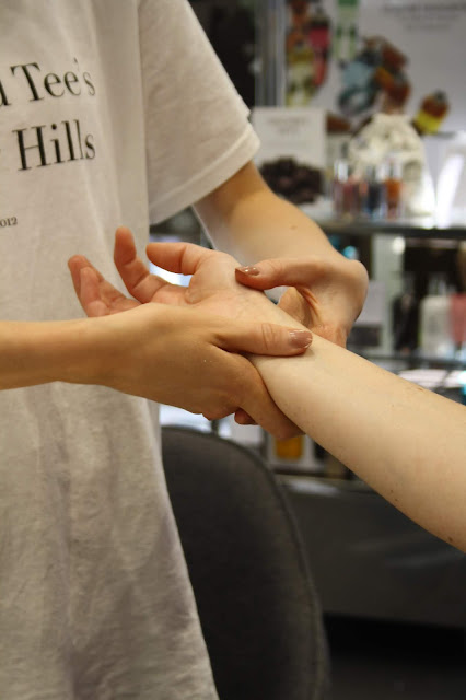 Abbey receiving a hand and arm massage at the Molton Brown store
