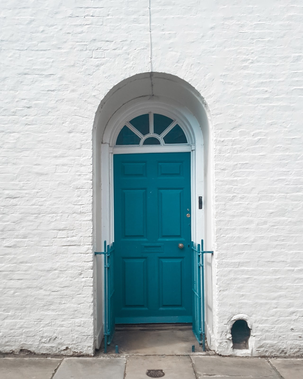image is of a blue door on a white building, located in York Yorkshire UK