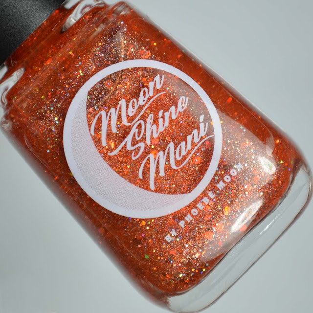 orange holographic nail polish in a bottle