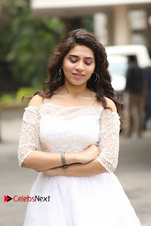 Actress Tejaswini Pictures in White Dress at Lachhi Teaser Launch  0019.JPG