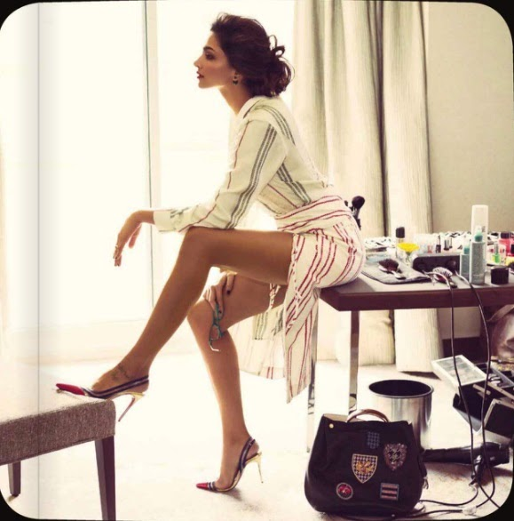 Deepika Padukone showing sexy long legs in mini skirt in Vogue Magazine