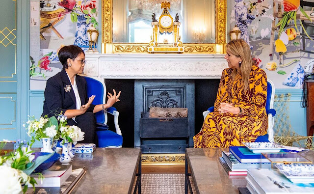 Queen Maxima wore a botanical print silk maxi dress from Johanna Ortiz. Foreign Minister Retno Marsudi