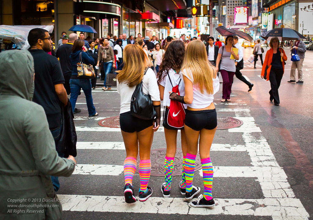 a photo of three young women in brightly colored socks in new york city