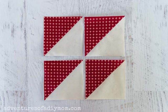 four red and white half square triangles