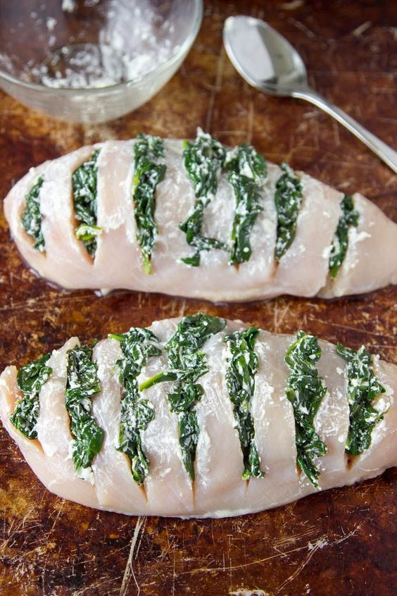 This is one of the easiest and quickest ways to make super delicious and flavorful chicken breasts. By making slits in the chicken breasts (Hasselback) and stuffing them with tasty things like spinach and goat cheese, you'll get a hit of savory cheesy goodness in every bite!