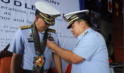 A Philippine Coast Guard Guest Speaker receives a colorful lei in Metro Manila, Philippines