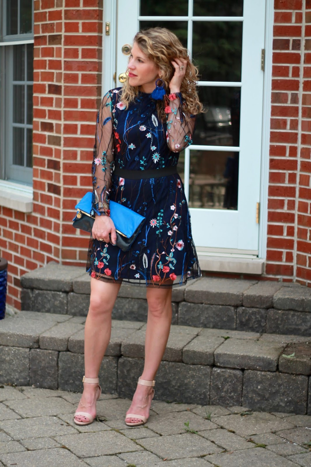 mesh floral embroidered dress, blue clutch, blue tassel earrings, nude heels