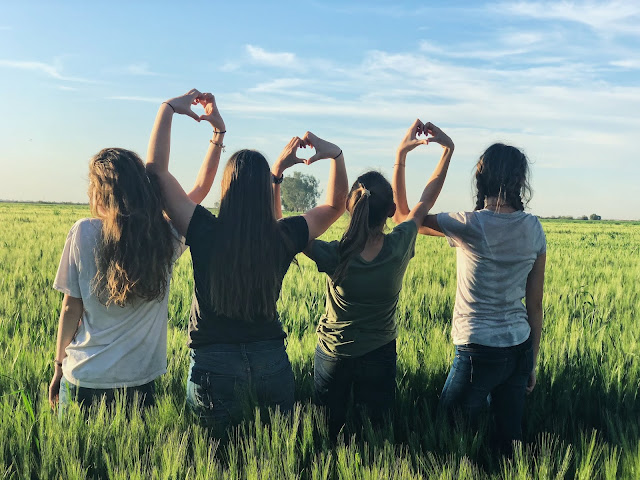 Teen girls in a field together