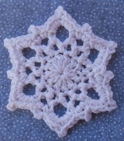 http://www.ravelry.com/patterns/library/snowflake-coaster-or-ornament