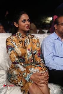 Actress Rakul Preet Singh Stills in Short Dress at Dhruva Pre Release Function  0046.JPG