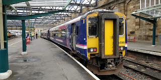A Northern 156 'Super Sprinter' in the remains of First Scotrail livery at Carlisle station.