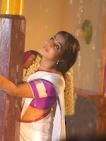 Poorna photos from Telugu movie Avanthika-cover-photo