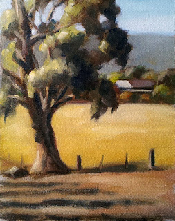 Oil painting of a large eucalypt near a fence, with a house surrounded by trees and hills in the distance.