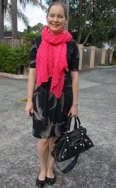 leona edimston fern print black dress with hot pink crinkle scarf and balenciaga bag in office | away from blue