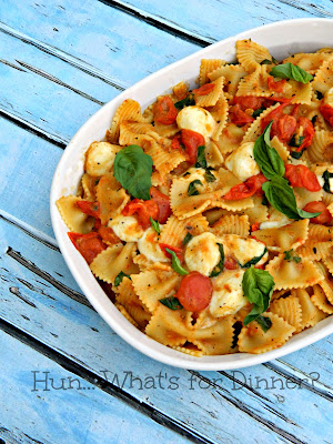 Hun... What's for Dinner? Caprese Pasta- Basil, tomatoes and fresh mozzarella are the star in this delicious pasta.