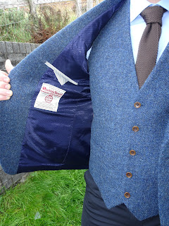 blue tweed jacket and waist coat and brown matching tie