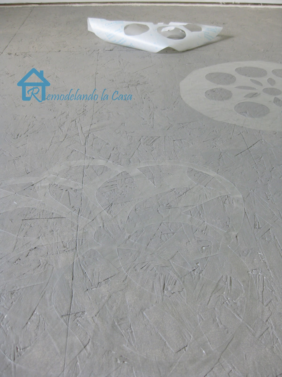 contact paper used as stencil to paint floor