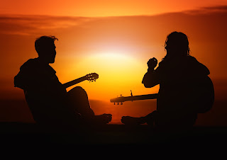 playing guitars against the sunset